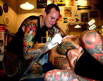 Brandon Notch tatooing painting